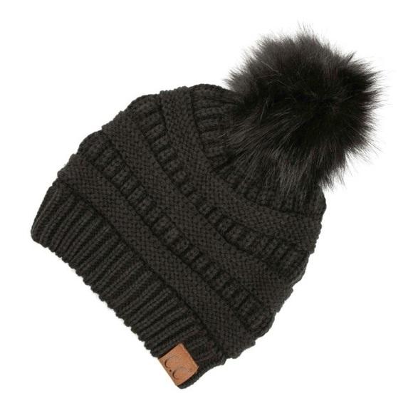 dd3ccf8862a Black Pom Pom C. C. Beanie hat
